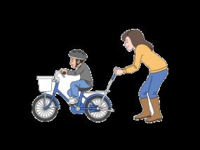 自転車の練習をする親子